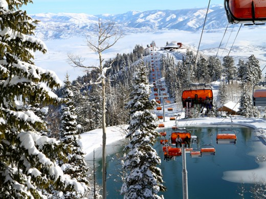 Orange lift chairs rise over the Canyons Resort in Park City, Utah